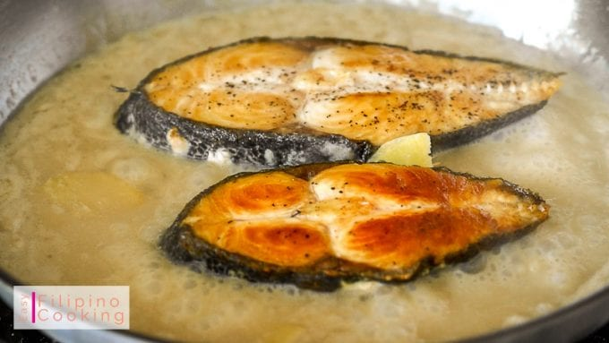 Picture of fish being cooked in coconut milk